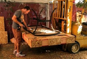 Employee packing an Italian volcanic table for shipment.
